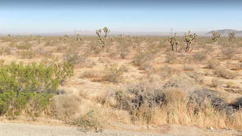 0.13 Acre Lot in Llano, CA. APN#3062-038-008 Street view of the property