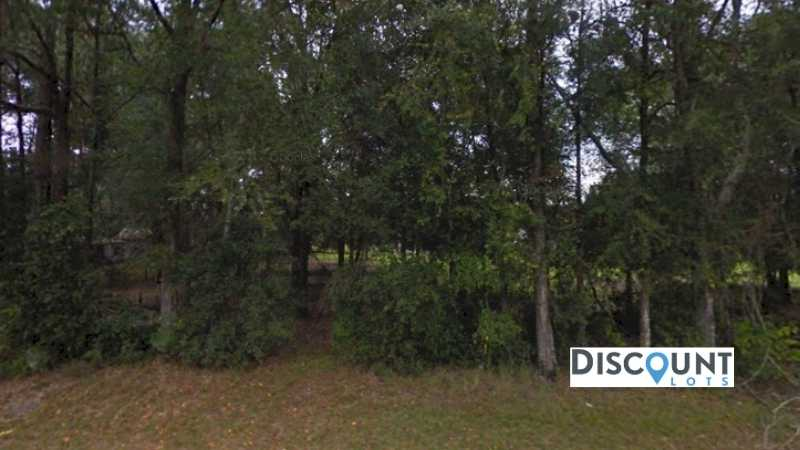 0.23 acres Lot in Live Oak,FL. APN# 0401S12E09391120480 Street view of the property
